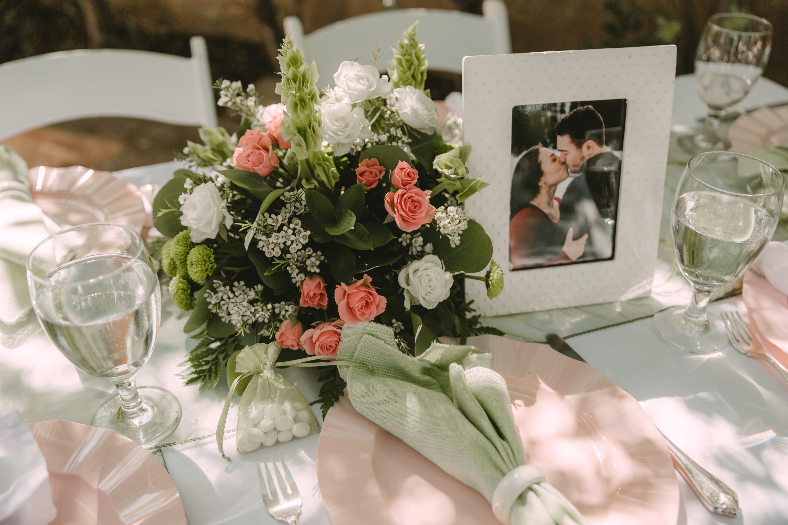 Sage, Cream, and Pink Bouquet on Wedding Table